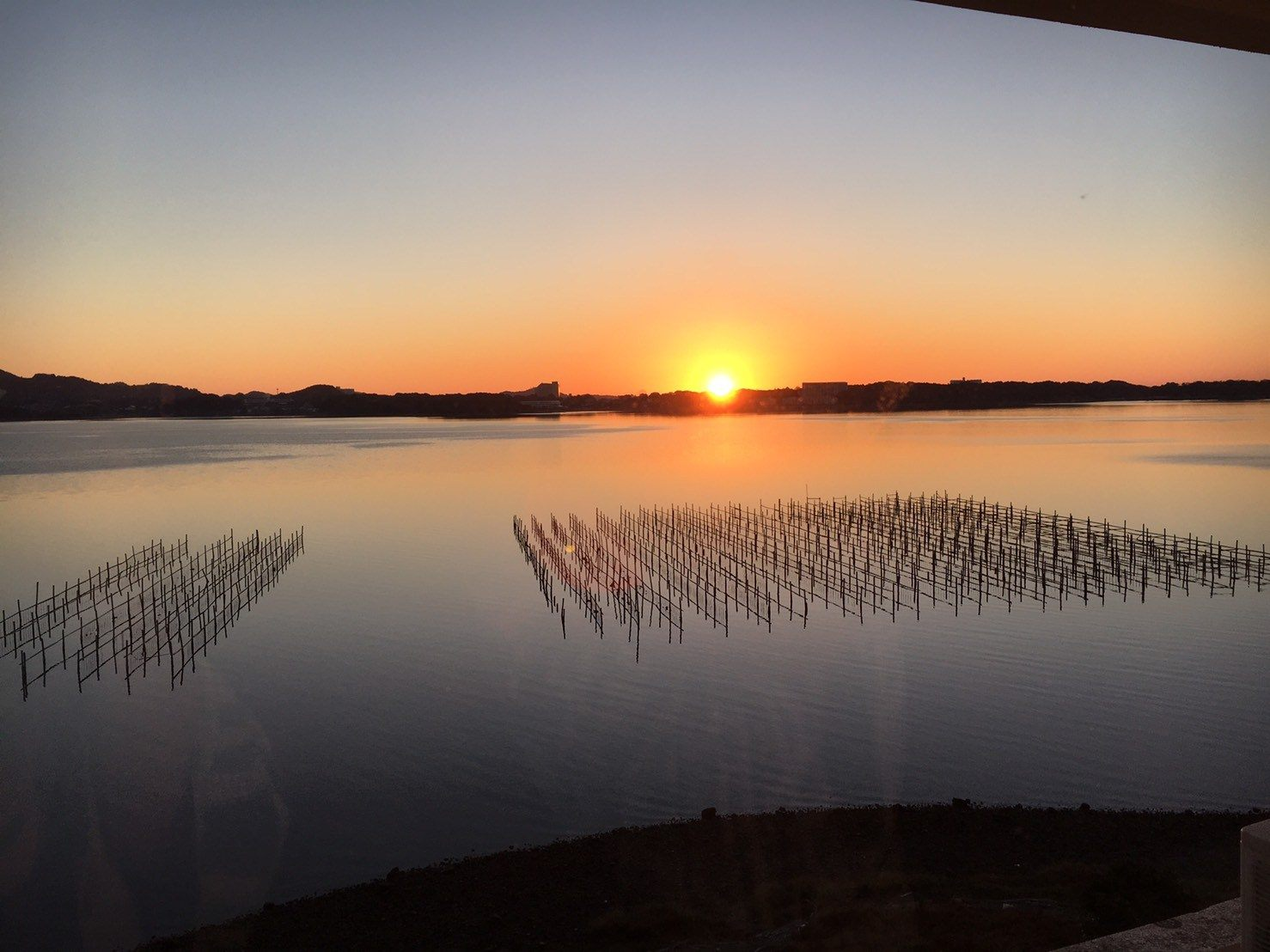 The sun rising over Lake Hamana for the first time in 2017