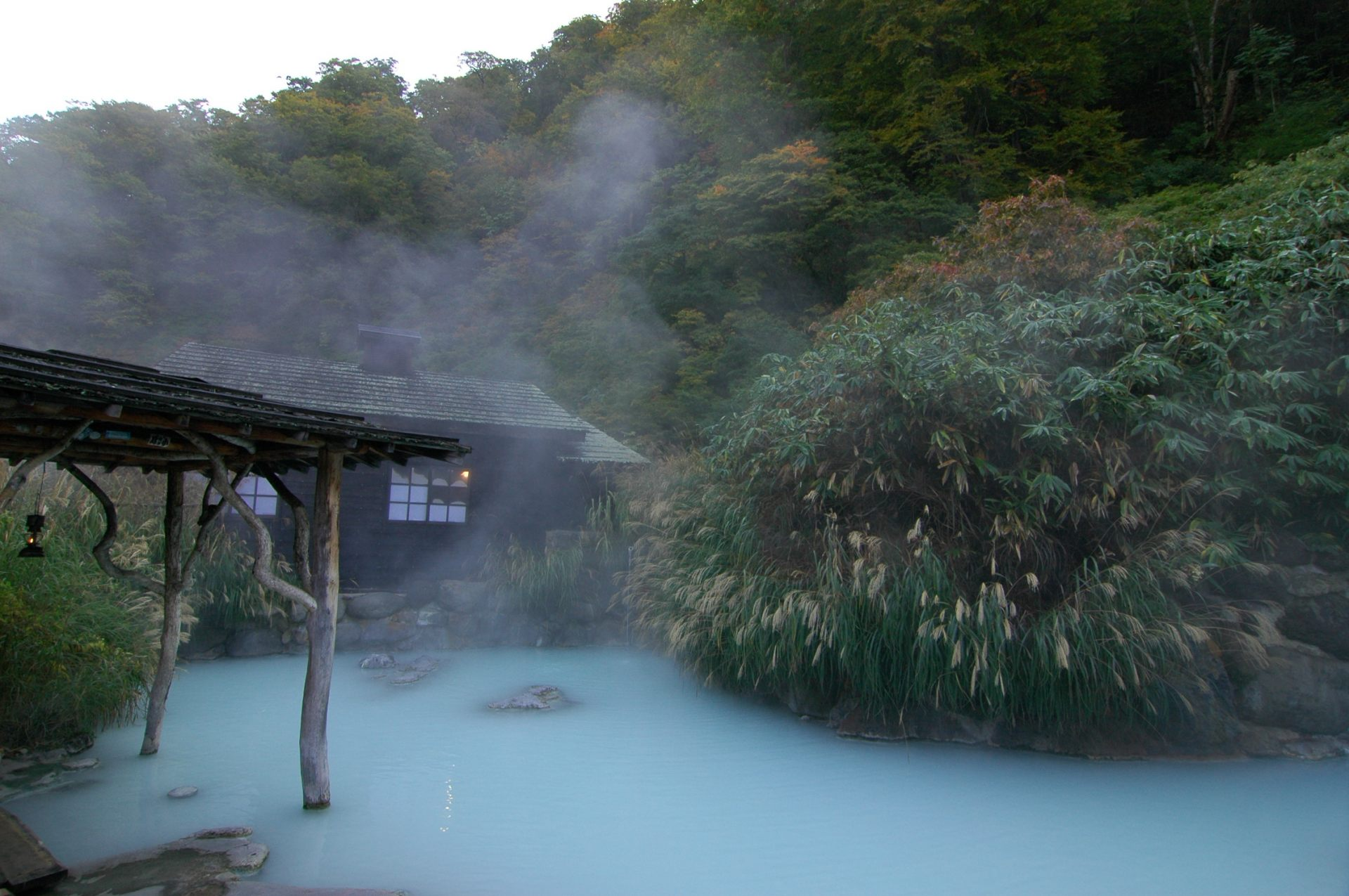 Tsurunoyu Onsen's open-air bath for mixed bathing. The milky hot spa water comes up from the bath floor.