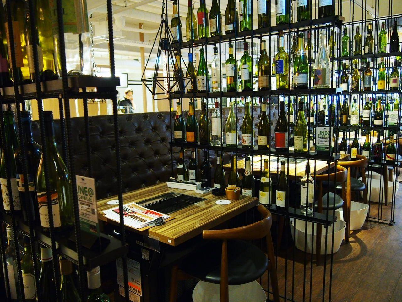 wine bottles serve as partitions between neighboring seats