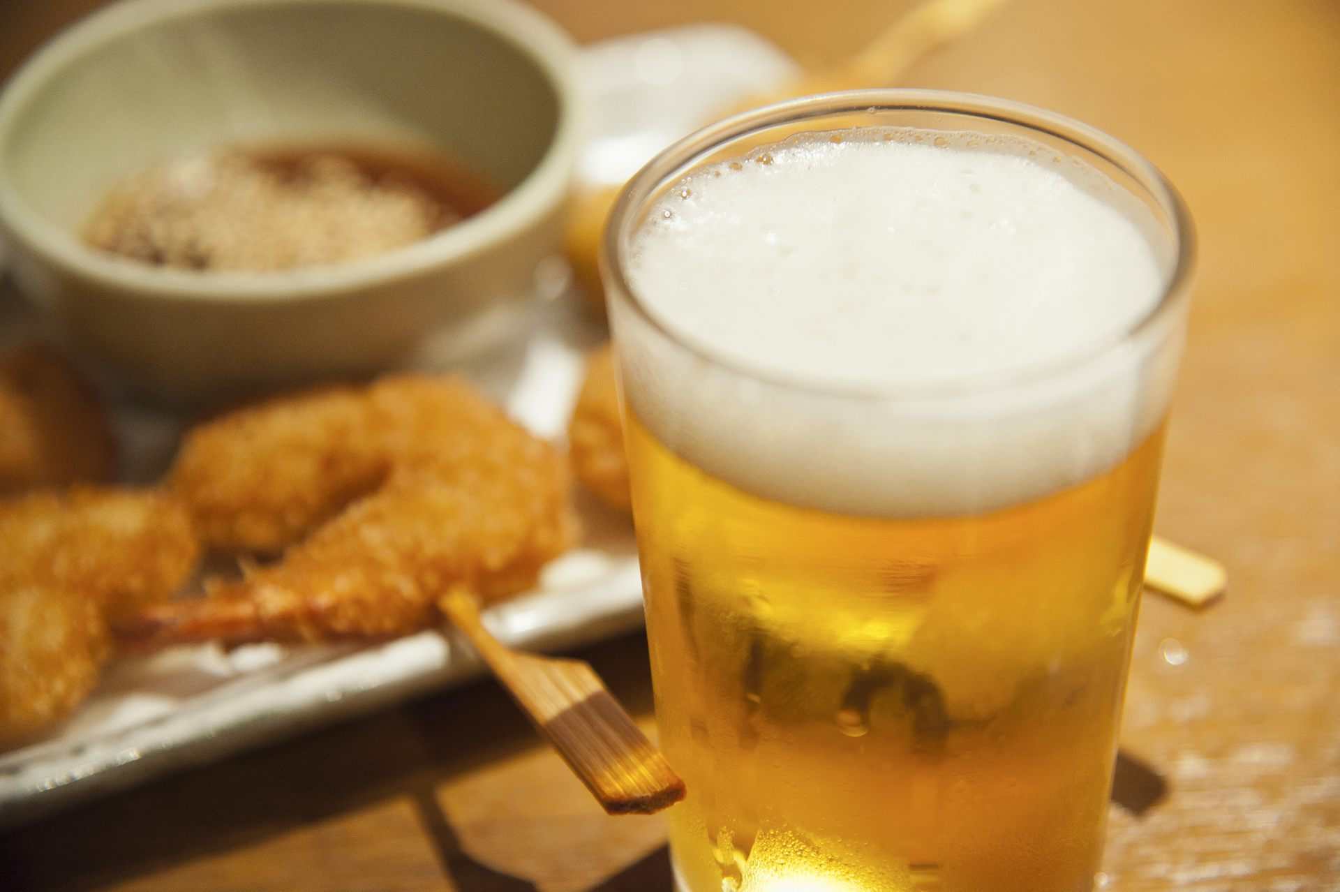 "Beer and ""Kushiage"" (fried morsels on a stick) at an ""Izakaya"" pub"