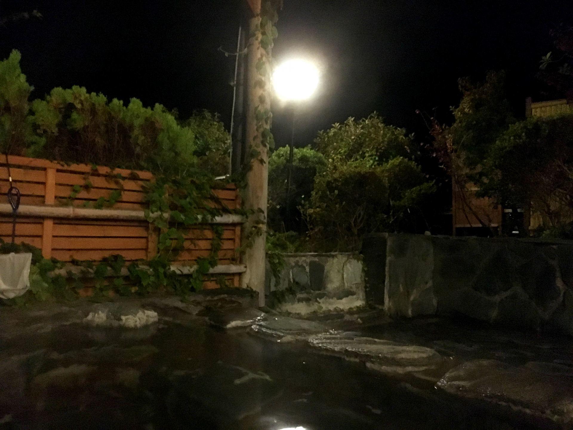 Open door hot spring at night