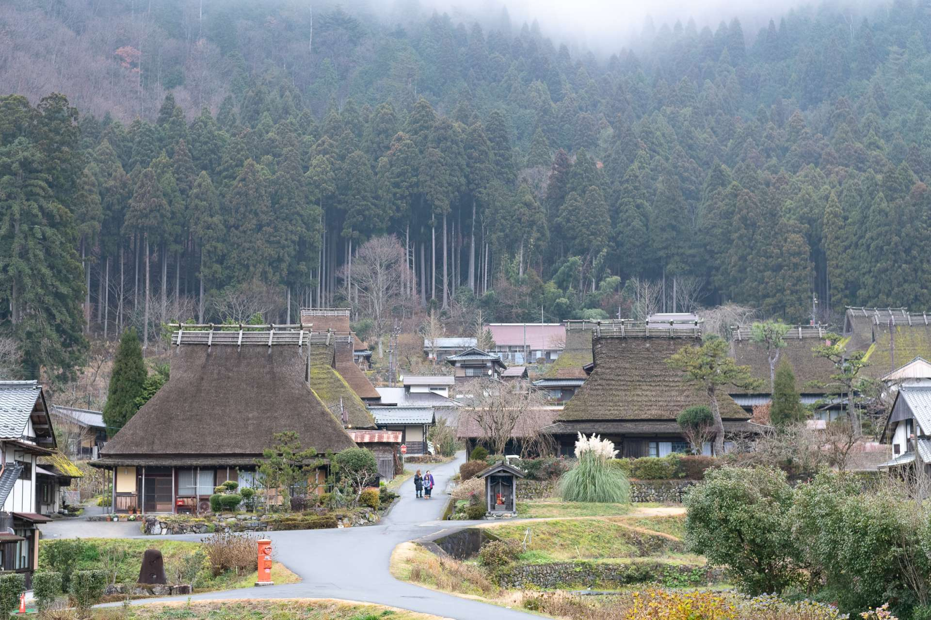 """""""Kayabuki no Sato"""" consists of 39 thatch roof houses (Chii district, Miyama). It was selected as a national important preservation district of historic buildings along with the surrounding rice paddies and mountain forests in 1993."""