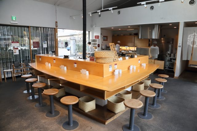 The inside of Kamado with center counter and table seating.