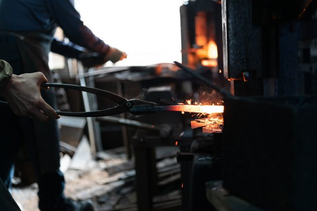 Sparks fly at this foundry which produces planes.
