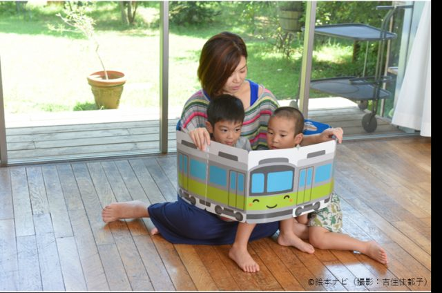 A parent being close with their children with a picture book