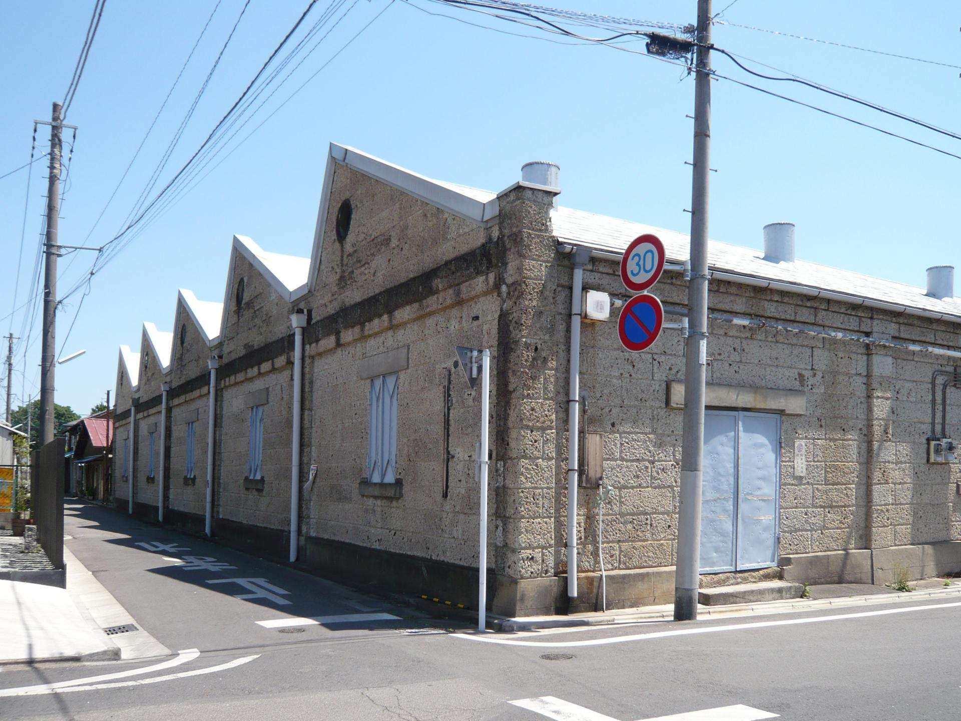 Former Soga Textile Mill. The saw-tooth roofed building is a landmark of the area.