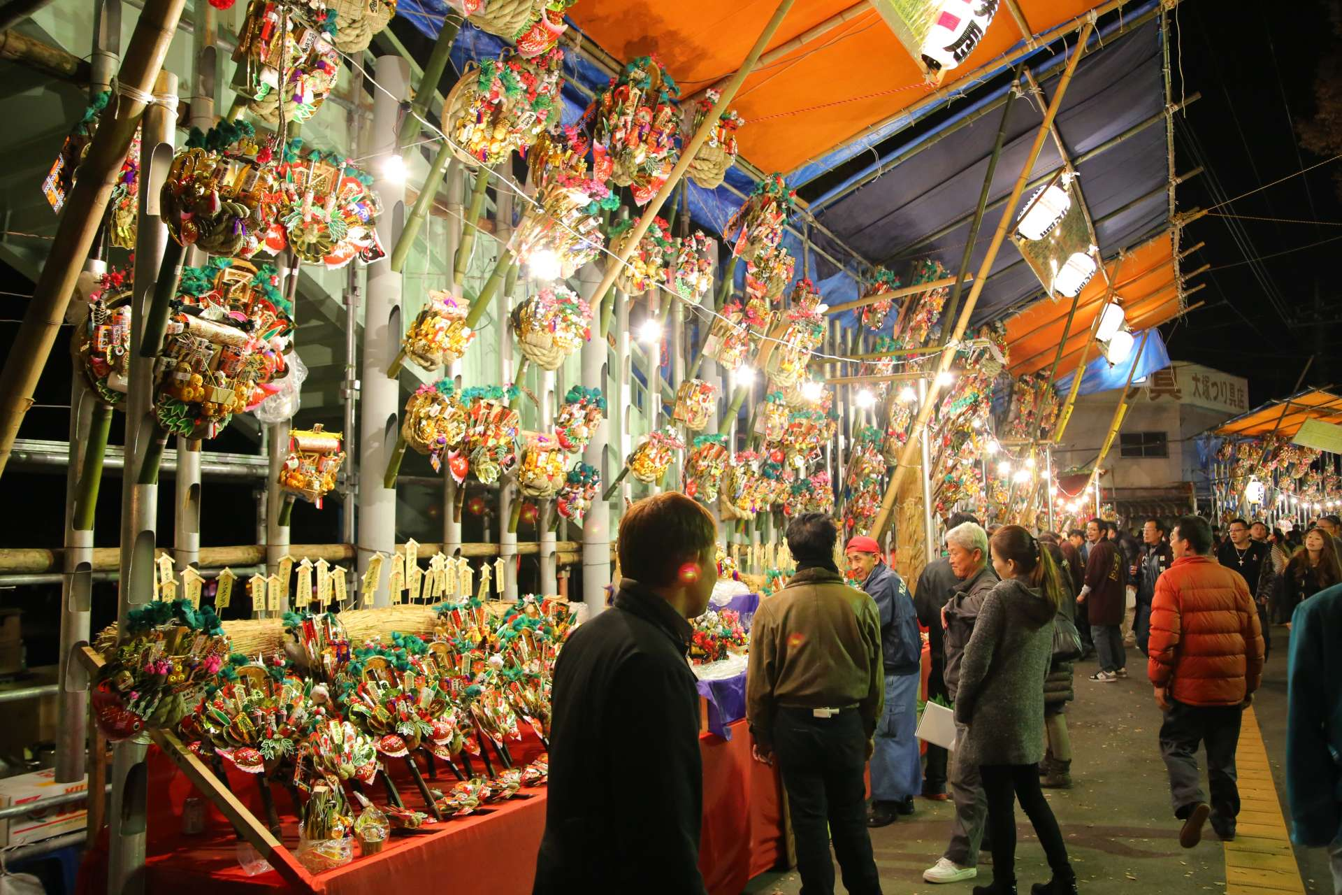 Dazzling bamboo rakes and charms lining the street stalls. Even just looking is fun.