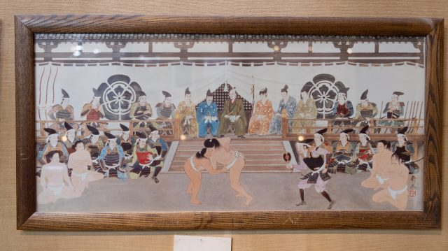 A drawing of a sumo wrestling match that took place in front of Oda Nobunaga, a wartime general representative of Japan.